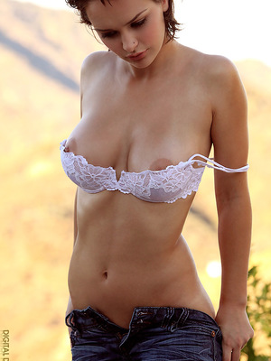 strips off her white bra and blue jeans for you